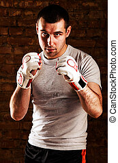 fighter - portrait of mma fighter in boxing pose against...