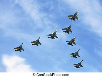 Fighters in flight - Group of russian fighters flying in a...