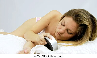 Fighting in bed with alarm clock
