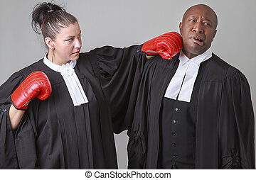 fighting lawyer - caucasian woman wearing a lawyer toga...