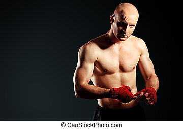 fighting man - Portrait of a muscular boxer in red gloves...
