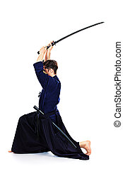 fighting pose - Handsome young man practicing kendo....