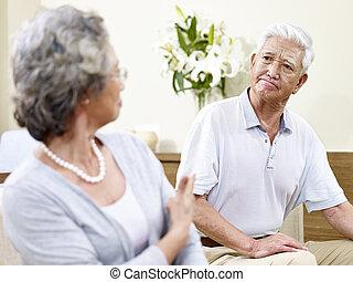 fighting senior asian couple