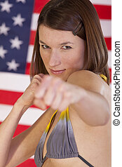 fighting woman over american flag