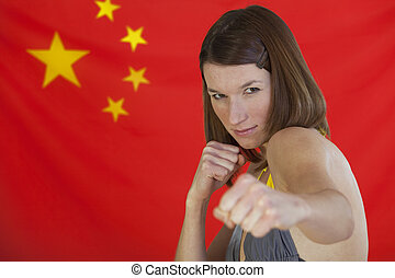 fighting woman over china flag