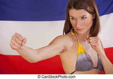 fighting woman over dutch flag