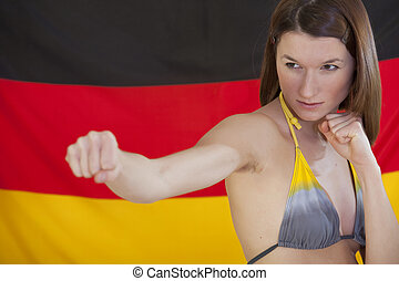 fighting woman over german flag