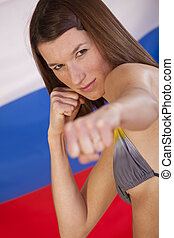 fighting woman over russian flag