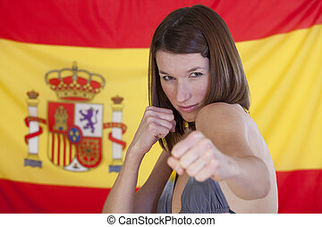 fighting woman over spain flag