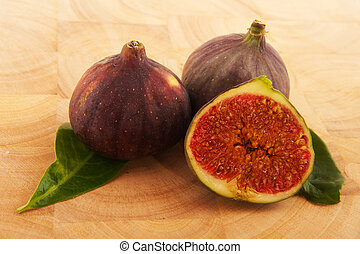 Figs fruit on a natural wooden timber