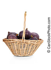 Figs in a basket isolated on white background