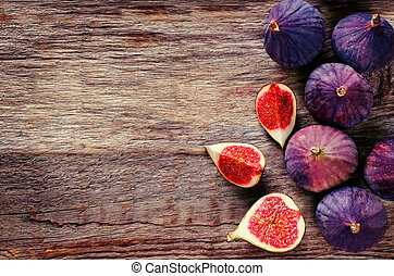 figs on a dark wood background. tinting. selective focus on...