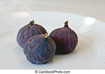 Figs on a white plate
