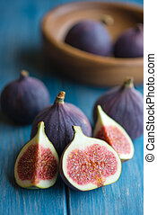 Figs on rustic table - Group of figs in a bowl and on rustic...