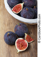 Figs on wooden table still life
