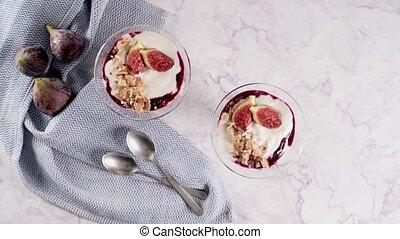 Figs pudding parfait with yogurt, blueberry jam, figs,...