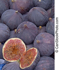 Figs - Group of figs, one halved.