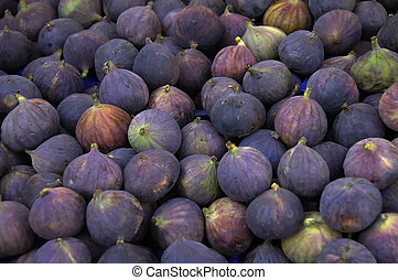 Figs - An array of fresh purple figs. Shallow depth of field