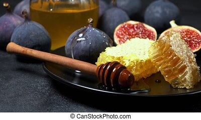 Figs with honey on in the plate on dark concrete background...