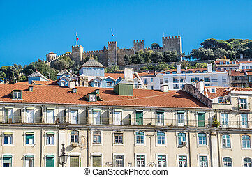 Figueira Square (or Praca da Figueira) in Lisbon, Portugal. View of castle.