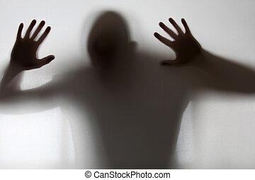 figura shadowy, apanhado, atrás de, vidro