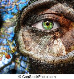 figure, à, oeil vert, et, peint, tronc arbre