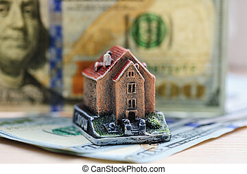 figure at home on a background of hundred dollar bills....