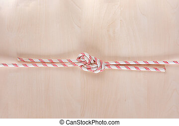Figure eight Bend or Flemish Bend ship knot on wooden ...