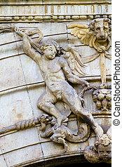 Figure, facade of the University of Alcala de Henares, Madrid, Spain