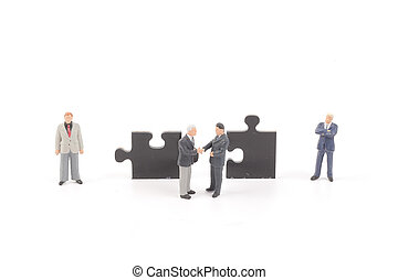 figure holding up jigsaw puzzle pieces