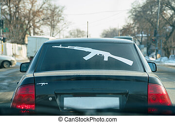 Kalashnikov Rifle on the rear window of the car