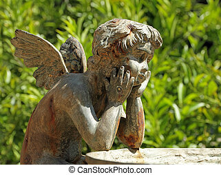 figure of angel - detail of the fountain in garden of Villa...