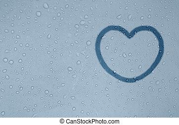 Figure of heart on a foggy window - Shape of heart is drawed...