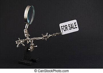 """figure of steel man with """"for sale"""" inscription"""