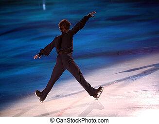 Figure skater - Professional man figure skater performing at...