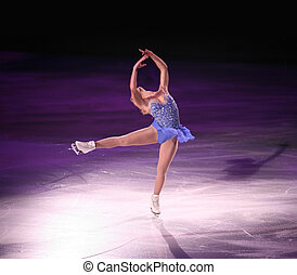 Professional woman figure skater performing at Stars on ice show