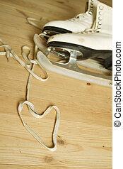 Figure Skates - Old skates for figure skating are on a...