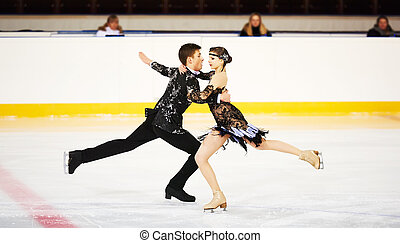 figure skating at sports arena - figure skating of young...