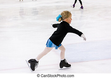 Figure skating - Cute young girl practicing figure skating...