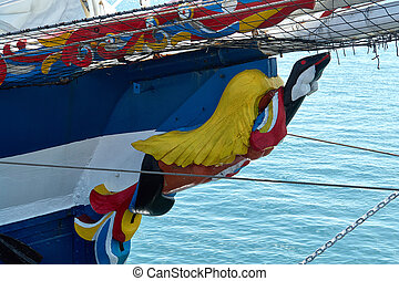 Traditional colorful figurehead on an old sailing wooden ship