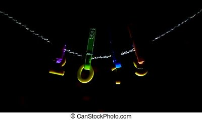 Figures 2019 hanging on clothespins and a rope, Christmas lights are on the background, the new year 2019, Christmas, colorful, Xmas