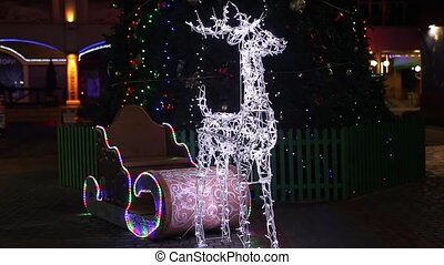 Figures of shone deer with sledge and illuminated lights
