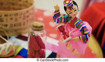 figurine is a traditional Korean doll to the celebration of...