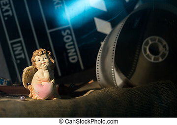 Figurine little angel with a heart who dreams against the...
