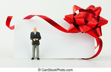 Figurine of businessman with gift card