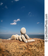 Figurine on coast