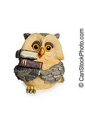 Figurine owl sitting with books