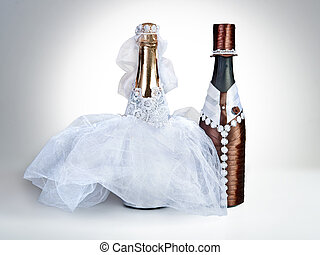 Souvenir bottles for a wedding on a grey background