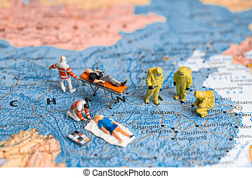 Figurines on map of China. Medical team with patients