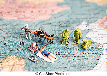 Figurines on map of China. Virus fighting concept.